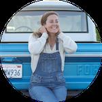 Allie sitting on truck bumper